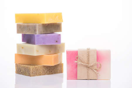 Photo of variety of homemade colorful soap bars isolated on white background