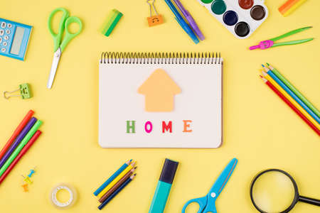 Social distancing concept. Top above overhead view photo of notebook colorful stationery isolated on yellow background