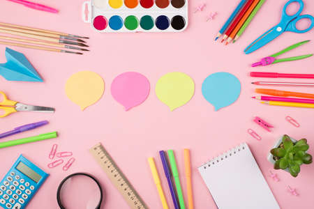 Exressing thoughts and ideas at school and work concept. Communication concept. Top above overhead view photo of colorful stationery paper clouds and succulent isolated on pastel pink background