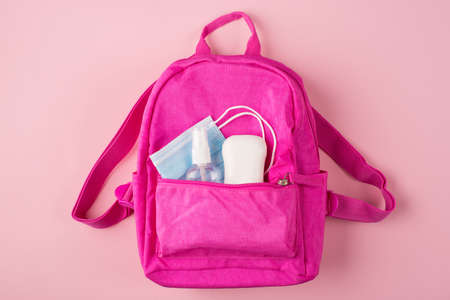 Top above overhead view photo of pink backpack mask soap and sanitizer isolated on pastel pink background Standard-Bild