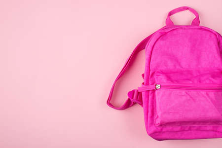 Studying concept. Top above overhead view photo of pink backpack isolated on pastel pink background with copyspace