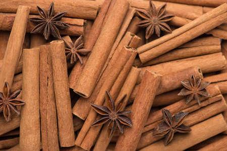 Photo of cinnamon sticks and anise stars macro background Standard-Bild