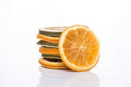 Photo of mixed dried lemon and orange slices stack isolated on white background