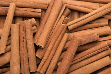 Close up macro photo of tasty cinnamon sticks background