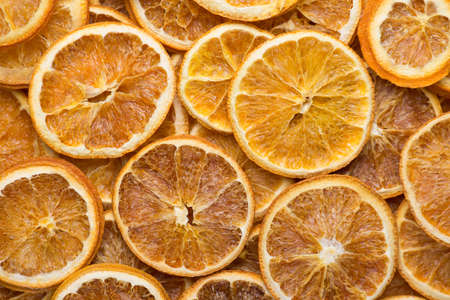 Dried fruit decoration concept. Top above overhead view close-up flat-lay photo of dried orange slices background