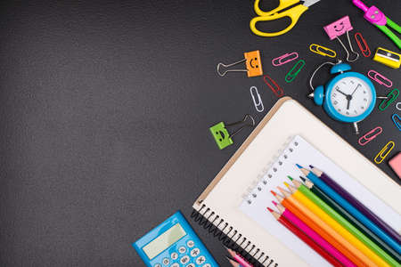 Stationery shopping concept. Top above overhead view photo of colorful stationery isolated on blackboard