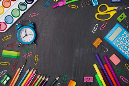 Back to school concept. Top above overhead view photo of colorful stationery making center empty isolated on blackboard