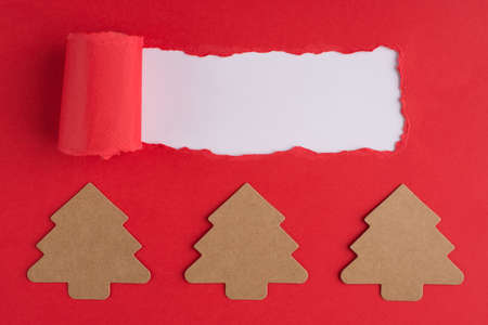 Christmas holiday concept. Top above overhead view photo of christmas tree shaped paper and torn red paper over white background with copyspace