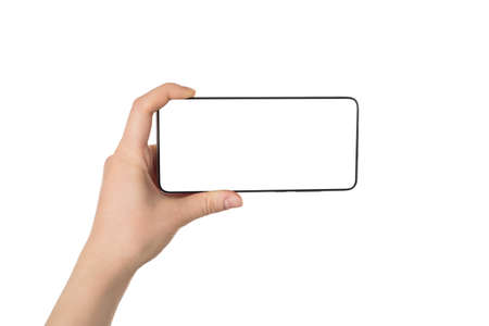 Taking picture concept. Pov first person view photo of female hand holding telephone in horizontal position taking image isolated white background