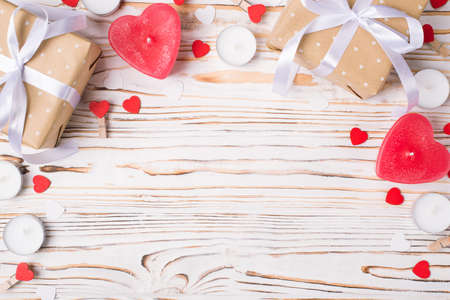 St valentines day layout composition. Top above close up view photo image of wrapped presents with ribbon bow red hearts empty place on wooden backdrop 写真素材