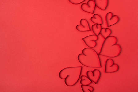 Valentines day flat lay background made of beautiful red hearts with place for text