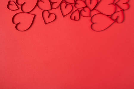 Red bright color monochromatic backdrop with hearts on the top of the picture