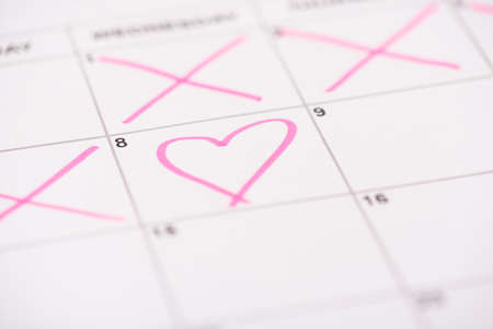 Happy women's day concept. Close up photo picture of calendar cell and and drawn pink heart on it 写真素材