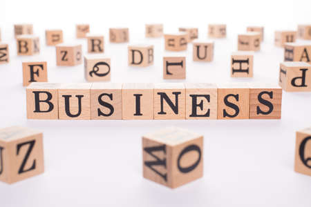 Business concept. Close up view photo of wooden cubes making word business isolated white backdrop 写真素材
