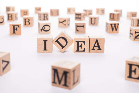 idea concept. Close up view photo of wooden cubes showing making word idea on white table desk background