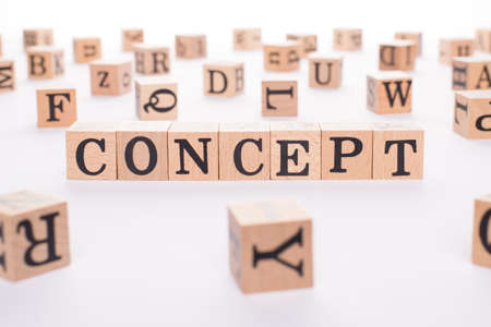 Close up photo of wooden blocks cubes making showing word concept on white table