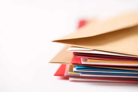 Closeup photo of stack of colorful envelopes on isolated white background