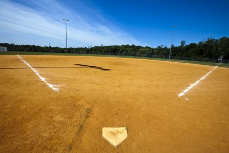 Baseball field with green grass and lines.