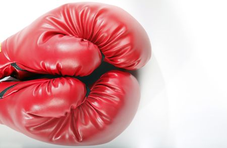Red boxing gloves on a white back ground Stock Photo - 5435294