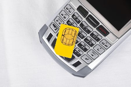 Sim card on top of a cell phone. Stock Photo - 5436045