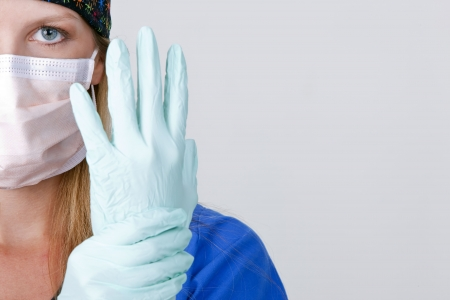 Medical personnel wearing a mask and gloves on white photo