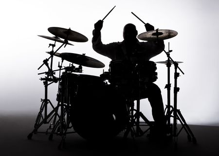 Siloutte of a male drummer in the studio Stock Photo