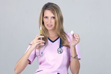A medical nurse holding a syringe on a white background photo
