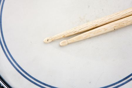 A set of drum sticks on a snare drum ready for playing. photo