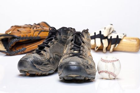 Used baseball cleats against a white background photo