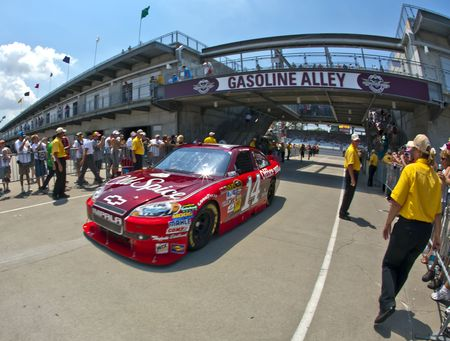 INDIANAPOLIS, IN - JULY 24, 2010:  Tony Stewart brings his Old Spice Chevrolet back into the garage area during a practice session for the Brickyard 400 race at the Indianapolis Motor Speedway in Indianapolis, IN. Stock Photo - 7438715