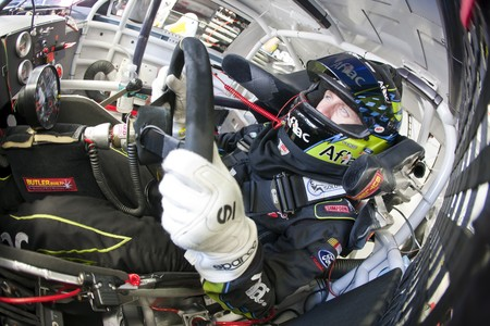 INDIANAPOLIS, IN - JULY 24, 2010:  Carl Edwards straps into his Aflac Ford before a practice session for the Brickyard 400 race at the Indianapolis Motor Speedway in Indianapolis, IN. Stock Photo - 7514574
