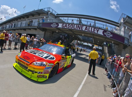 INDIANAPOLIS, IN - JULY 24, 2010:  Jeff Gordon brings his DuPont Chevrolet back into the garage area during a practice session for the Brickyard 400 race at the Indianapolis Motor Speedway in Indianapolis, IN. Stock Photo - 7514577