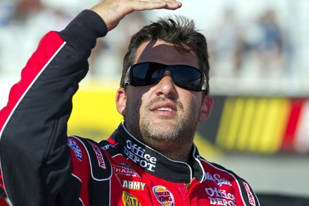 tn: Bristol, TN - AUG 20, 2010:  Tony Stewart watches the leader board before he qualifies for the Irwin Tools Night Race race at the Bristol Motor Speedway in Bristol, TN.