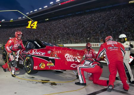 tire tracks: Bristol, TN - AUG 21, 2010:  Tony Stewart brings his Office Depot Chevrolet in for service during the Irwin Tools Night Race race at the Bristol Motor Speedway in Bristol, TN. Editorial