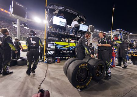 roush: Bristol, TN - AUG 21, 2010:  The Aflac Team do their duties after a pit stop during the Irwin Tools Night Race race at the Bristol Motor Speedway in Bristol, TN.