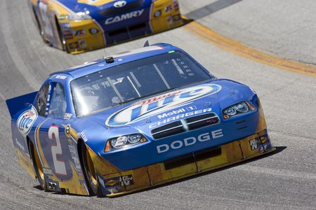HAMPTON, GA - SEP 04, 2010:  Kurt Busch brings his Miller Lite Dodge through the turns during a practice session for the Emory Healthcare 500 race at the Atlanta Motor Speedway in Hampton, GA.