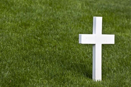 omaha: A lone marble cross at a cemetery Stock Photo