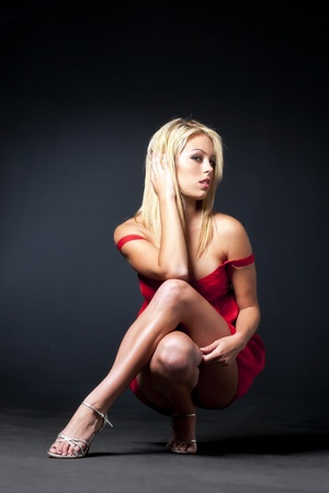 sensuous: A blonde model in a sensuous pose against a black background Stock Photo