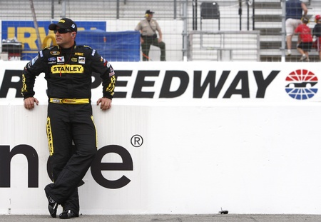 tn: Bristol, TN - AUG 26, 2011:  Marcos Ambrose (9) gets ready to qualify for the Irwin Tools Night Race race at the Bristol Motor Speedway in Bristol, TN. Editorial