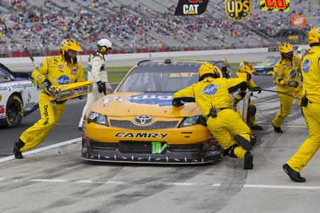 Hampton, GA - September 06, 2011:  Kyle Busch (18) brings his Pedigree Toyota in for service during the Advocare 500 race at the Atlanta Motor Speedway in Hampton, GA.