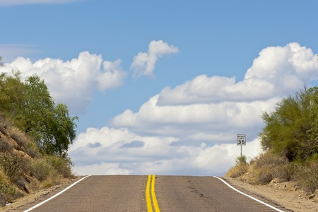 endless: Endless road with clouds against a blue sky Stock Photo