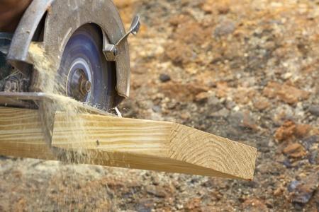 build buzz: A carpenter cutting wood using a circular saw