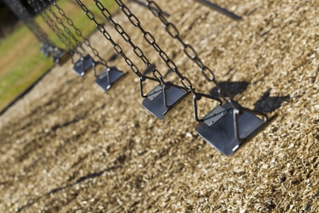 A set of empty playground swings photo