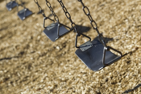 A set of empty playground swings