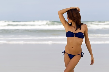 A young female model enjoying a day at the beach Stock Photo - 12594572