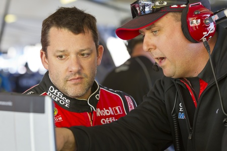 AVONDALE, AZ - Mar 02, 2012   Tony Stewart  14  talks with his crew during a practice session for the Subway Fresh Fit 500 race at the Phoenix International Raceway in Avondale, AZ