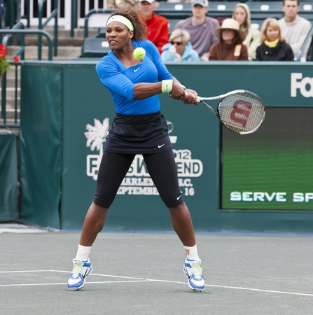 CHARESTON, SC - APR 06, 2012   Serena Williams  USA , returns a volley during her match against Sabine Lisicki  GER  during their quarterfinals match at the Family Circle Cup tennis tournament in Charleston, S C , Friday, April 6, 2012  Lisicki later with