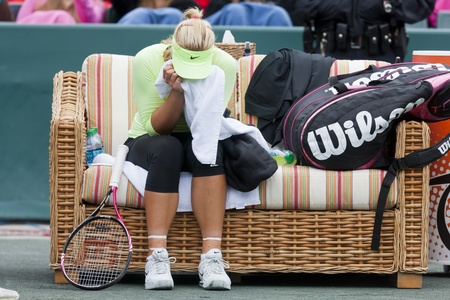 ger: CHARESTON, SC - APR 06, 2012   Serena Williams  USA , consoles Sabine Lisicki  GER , after Lisicki had to withdraw from their quarterfinals match due to a sprained ankle at the Family Circle Cup tennis tournament in Charleston, S C , Friday, April 6, 2012 Editorial