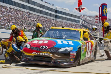 DOVER, DE - JUN 03, 2012   Kyle Busch  18  brings in his MMs Toyota for service during the FedEx 400 Benefiting Autism Speaks at the Dover International Speedway in Dover, DE  Editoriali