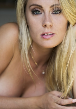 A blonde model posing with natural lighting Stock Photo - 14341084